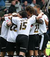 Photo: Dave Linney.<br />Derby County v Burnley. Coca Cola Championship. 11/03/2006.Derby players surround goalscorerTommy Smith