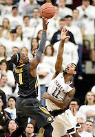 Texas A&M's Anthony Collins (11) reaches out to try and block a shot by Missouri's Terence Philips (1) during the first half of an NCAA college basketball game, Saturday, Jan. 23, 2016, in College Station, Texas.  (AP Photo/Sam Craft)