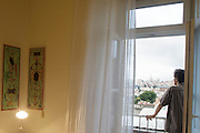 "A man looks at the view from one of the rooms's balconies at hotel ""Casa das Janelas com Vista"" in Lisbon, Portugal"