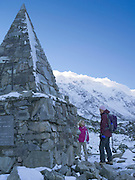 A woman and girl reflect on the memorial to perished climbers at Aoraki/Mt. Cook National Park, New Zealand