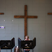 CHARLOTTE, NC - NOVEMBER 6: A resident of Mecklenburg County in Charlotte, NC casts her ballot at precinct #75 on November 6, 2018. Many states are expecting a record turnout for the 2018 midterm election highlighting deep divisions between Democrats and Republicans. (Photo by Logan Cyrus for AFP)