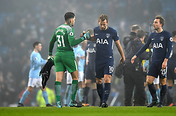 Manchester City goalkeeper Ederson shakes hands with Tottenham Hotspur's Harry Kane after the final whistle