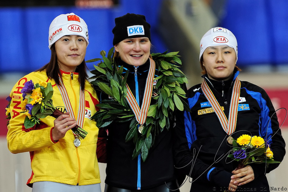 Wang Beixing (CHN), Jenny Wolf (GER), and Lee Sang-Hwa (KOR) celebrate their medal winning performances in the ladies 500m event at the 2009 Essent ISU World Single Distances Speed Skating Championships.