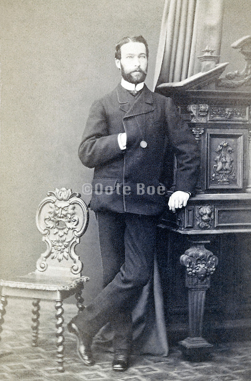 portrait man standing late 1800s