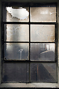 a very dusty window in old factory building