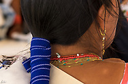 Kichwa woman,adorned in her traditional jewelry, and hair.