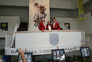 28 August 2006: 2006 player inductees (from left) Al Trost, Carla Overbeck, and Alexi Lalas pose together in the Hall of Fame atrium after the ceremony. The National Soccer Hall of Fame Induction Ceremony was held at the National Soccer Hall of Fame in Oneonta, New York.