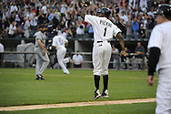 CHICAGO - SEPTEMBER 10:  Juan Pierre #1 reacts after Alex Rios #51 of the Chicago White Sox hit a walk-off grand slam home run in the bottom of the tenth inning off of Chris Perez #54 of the Cleveland Indians on September 10, 2011 at U.S. Cellular Field in Chicago, Illinois.  The White Sox defeated the Indians 7-3.  (Photo by Ron Vesely)   Subject: Alex Rios;Chris Perez;Juan Pierre