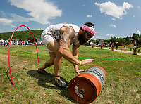 """Mr. Brimbles (Tony Hersey) of the""""We're Not Cat Drunk"""" team scambles through the """"Keg Croquet"""" game during the Craft Beer Relay at Gunstock Mountain Resort on Saturday.  (Karen Bobotas/for the Laconia Daily Sun)"""