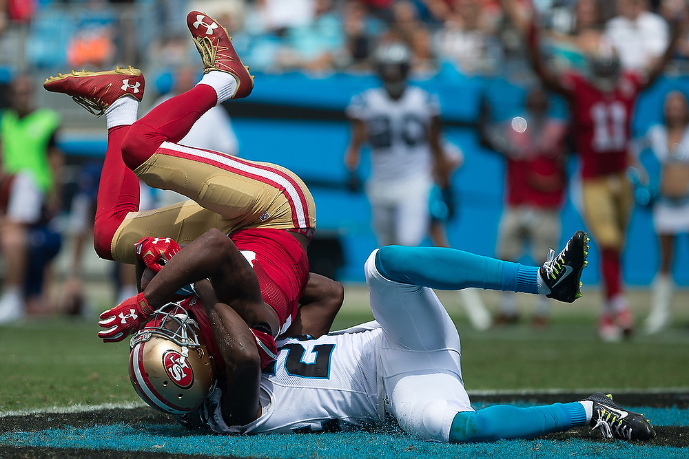 San Francisco's Torrey Smith (82) is tackled into the end zone by Carolina's James Bradberry (24) for a second-quarter touchdown. <br /> San Francisco 49ers vs Carolina Panthers at Bank of America Stadium in Charlotte, N.C., on Sunday, Sept. 18, 2016. <br /> Zach Bland Photo