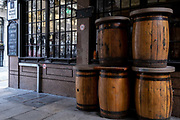 Wooden barrels that normally serve as drinks tables remain stacked outside the closed Bunch of Grapes pub on Beehive Passage during the third lockdown of the Coronavirus pandemic, in the City of London, the capitals financial district, aka The Square Mile, on 2nd February 2021, in London, England.