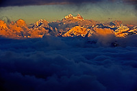 Russia, Caucasus, mountain range seen from Elbrus in late evening, last light with fog in the valley. The double mountain in the middle of the picture is Ushba, which is just on the Georgian side of the border.