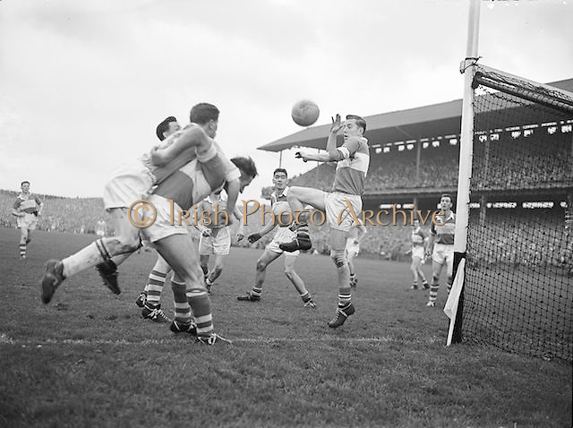Derry makes a desperate attempt to prevent Dublin from scoring another goal during the All Ireland Senior Gaelic Football final Dublin vs Derry in Croke Park on 28th September 1958. Dublin 2-12 Derry 1-9.