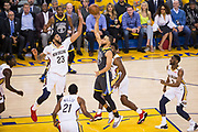 Golden State Warriors guard Stephen Curry (30) shoots a floater against the New Orleans Pelicans at Oracle Arena during Game 2 of the Western Semifinals in Oakland, California, on May 1, 2018. (Stan Olszewski/Special to S.F. Examiner)