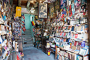 Book and vinyl record shop, with pictures of Che Guevara and revolutionary material, Santiago de Cuba, Cuba.