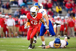 24 September 2011: With Ross Shafrath following and Mike Lien falling away, Tyrone Walker continues up the field during an NCAA football game between the South Dakota State Jackrabbits (SDSU) and the Illinois State Redbirds (ISU) at Hancock Stadium in Normal Illinois.