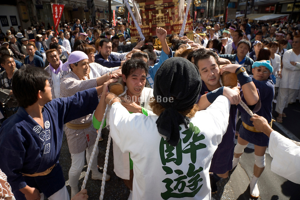 a Mikoshi Shrine carried through the streets