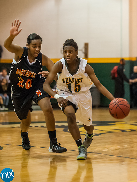 Central Cabarrus' NiAsia Bryant drives past Northwest Cabarrus' Joy Smith Friday night at Central Cabarrus High School. Central won the game 53-48.