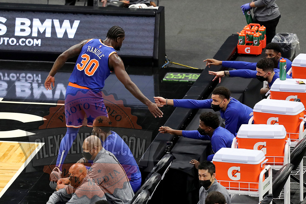 ORLANDO, FL - FEBRUARY 17:  Julius Randle #30 of the New York Knicks high fives teammates as he checks out against the Orlando Magic at Amway Center on February 17, 2021 in Orlando, Florida. NOTE TO USER: User expressly acknowledges and agrees that, by downloading and or using this photograph, User is consenting to the terms and conditions of the Getty Images License Agreement. (Photo by Alex Menendez/Getty Images)*** Local Caption *** Julius Randle