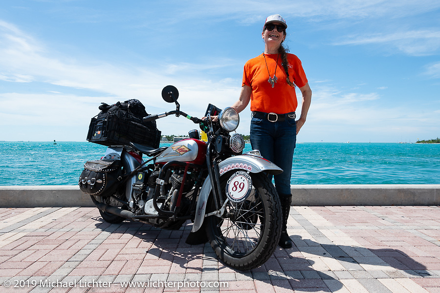 Cris Sommer-Simmons poses with her 1934 Harley-Davidson VD along the sea wall in Key West at the end of the Cross Country Chase motorcycle endurance run from Sault Sainte Marie, MI to Key West, FL. (for vintage bikes from 1930-1948). The Grand Finish in Key West's Mallory Square after the 110 mile Stage-10 ride from Miami to Key West, FL and after covering 2,368 miles of the Cross Country Chase. Sunday, September 15, 2019. Photography ©2019 Michael Lichter.