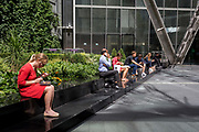 City workers enjoy their lunches in summer sunshine on Primrose Street in the City of London, the capitals financial district - aka the Square Mile, on 8th August, in London, England.