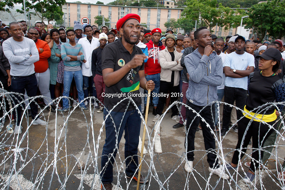 DURBAN - 14 October 2016 - Banda Lukhanyo Mtsingana speaks to media from behind barbed wire that students put out to prevent police from accessing their residence at the University of KwaZulu-Natal's Westville campus. Picture: Allied Picture Press/APP