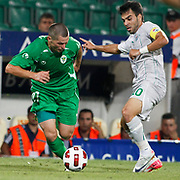 Bursaspor's Volkan SEN (R) and Gomel's Artur LEVITSKI (L) during their UEFA Europa League Third qualifying round, First leg soccer match Bursaspor between Gomel at the Ataturk stadium in Bursa Turkey on Thursday 28 July 2011. Photo by TURKPIX