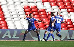 Nico Yennaris of Brentford of Brentford (L) celebrates scoring his sides second goal - Mandatory by-line: Jack Phillips/JMP - 02/04/2016 - FOOTBALL - City Ground - Nottingham, England - Nottingham Forest v Brentford - Sky Bet Championship