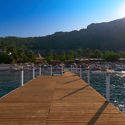 View of Kumlubuk beach and mountains from the pier, Marmaris, Turkey