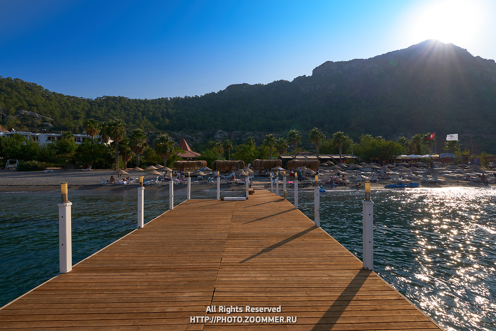 View of Kumlubuk beach and mountains from the pier, Marmaris, Turkey