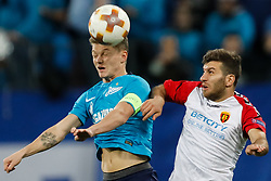 November 23, 2017 - Saint Petersburg, Russia - Oleg Shatov (L) of FC Zenit Saint Petersburg and Hovhannes Hambartsumyan of FK Vardar vie for a header during the UEFA Europa League Group L match between FC Zenit St. Petersburg and FK Vardar at Saint Petersburg Stadium on November 23, 2017 in Saint Petersburg, Russia. (Credit Image: © Mike Kireev/NurPhoto via ZUMA Press)