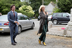 Actor Jack Donnelly arrives with partner Malin Akerman at Rayne Church, Kirkton of Rayne in Aberdeenshire, for the wedding ceremony of Game Of Thrones stars Kit Harington and Rose Leslie.