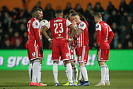 Brentford players discuss free-kick options during The FA Cup fourth round match between Barnet and Brentford at The Hive Stadium, London, England on 28 January 2019.