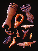 Assorted prehistoric Siberian Eskimo ivory artifacts including combs, seal lanyard and small animal fetishes and game pieces found on St. Lawrence Island and in the collection of Ellen Paneok, Alaska.