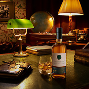 Whiskey bottle glass on a green leather covered desk with globe, books and reading glasses Ray Massey is an established, award winning, UK professional  photographer, shooting creative advertising and editorial images from his stunning studio in a converted church in Camden Town, London NW1. Ray Massey specialises in drinks and liquids, still life and hands, product, gymnastics, special effects (sfx) and location photography. He is particularly known for dynamic high speed action shots of pours, bubbles, splashes and explosions in beers, champagnes, sodas, cocktails and beverages of all descriptions, as well as perfumes, paint, ink, water – even ice! Ray Massey works throughout the world with advertising agencies, designers, design groups, PR companies and directly with clients. He regularly manages the entire creative process, including post-production composition, manipulation and retouching, working with his team of retouchers to produce final images ready for publication.