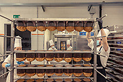 MILANO, The making  of Panettone. the Pasticceria Martesana workshop. once the panettone is cooked, must coold down upside down for hours. this must be done quite fast