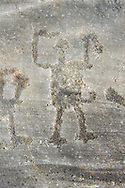 Petroglyph, rock carving, of a schematic human figure carved by the ancient Camuni people in the iron age between  900-1200 BC. Rock 26-27, Foppi di Nadro, Riserva Naturale Incisioni Rupestri di Ceto, Cimbergo e Paspardo, Capo di Ponti, Valcamonica (Val Camonica), Lombardy plain, Italy .<br /> <br /> Visit our PREHISTORY PHOTO COLLECTIONS for more   photos  to download or buy as prints https://funkystock.photoshelter.com/gallery-collection/Prehistoric-Neolithic-Sites-Art-Artefacts-Pictures-Photos/C0000tfxw63zrUT4<br /> If you prefer to buy from our ALAMY PHOTO LIBRARY  Collection visit : https://www.alamy.com/portfolio/paul-williams-funkystock/valcamonica-rock-art.html