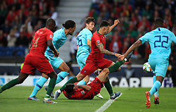 Portugal's players attempt a shot on goal during the Nations League Final at Estadio do Dragao, Porto.