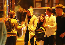Man City's injured goalkeeper Ederson is spotted on Deansgate with his family at about midnight walking back to his hotel