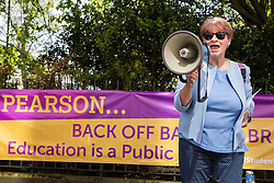 London, UK. 4th May, 2018. Christine Blower, President of the European Region at Education International, addresses members of the National Education Union (NEU) demonstrating outside the AGM of multinational assessment service Pearson in protest against investment by the corporation in 'low-fee' private schools provider Bridge. Bridge, one of the world's largest education-for-profit companies, aims to extend its influence throughout Africa and Asia.