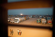 Almost 7 million tonnes are transhipped through the port annually. Every day, 500 Ethiopian trucks pass through, sometimes 200 for the WFP alone.  Loaded trucks bound to Ethiopia are stationed to clear custom at an area called PK12. 95% of the traffic going through the Djiboutian port goes to neighboring Ethiopia who does not have any coastline...The geostrategical and geopolitical importance of the Republic of Djibouti, located on the Horn of Africa, by the Red Sea and the Gulf of Aden, and bordered by Eritrea, Ethiopia and Somalia.
