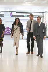 Prince Harry (centre) and Meghan Markle arrive for a reception with delegates from the Commonwealth Youth Forum at the Queen Elizabeth II Conference Centre, London, during the Commonwealth Heads of Government Meeting.