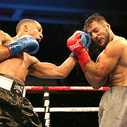 VERONA, NY - JUNE 09:  Nick Brinson (L) punches Jaime Barboza during a ShoBox boxing match at the Turning Stone Resort Casino on June 9, 2017 in Verona, New York. (Photo by Alex Menendez/Getty Images) *** Local Caption *** Nick Brinson;<br /> Jaime Barboza
