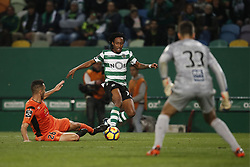 December 17, 2017 - Lisbon, Portugal - Sporting's forward Gelson Martins (C) vies for the ball with Portimonense's defender Ruben Fernandes (L) and Portimonense's goalkeeper Ricardo Ferreira (R)   during Primeira Liga 2017/18 match between Sporting CP vs Portimonense SC, in Lisbon, on December 17, 2017. (Credit Image: © Carlos Palma/NurPhoto via ZUMA Press)