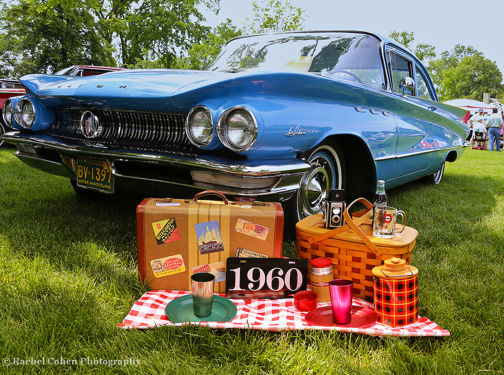 """""""1960""""<br /> <br /> The beautiful 1960 Buick Le Sabre in classic blue!!<br /> Adding to the charm are time period memorabilia displayed on a blanket in front of the car!!<br /> <br /> Cars and their Details by Rachel Cohen"""