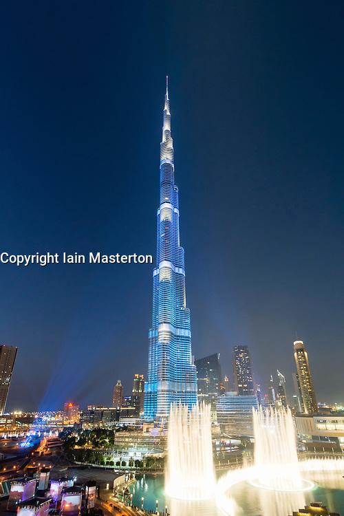 Burj Khalifa tower floodlit in blue during National Day celebrations on 2 1 December 2013 in Dubai United Arab Emirates
