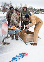 Dave Enser and Chet Wiess unload their fishing gear with Matt Adamchick and Robert Brehm on Meredith Bay Friday morning in preparation for the Great Meredith Rotary Fishing Derby starting Saturday.  (Karen Bobotas/for the Laconia Daily Sun)