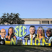 Travis' portraits of SEC Network talent are seen on the ESPN bus parked outside the Texas A&M stadium. (Photo by ESPN)