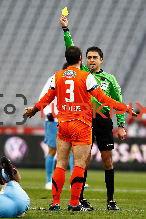 Referee's Bulent Yildirim show the yellow card to IBBSpor's Metin Depe during their Turkish soccer superleague match IBBSpor between Trabzonspor at the Ataturk Olympic stadium in Istanbul Turkey on Saturday 07 January 2012. Photo by TURKPIX