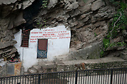 A eunuk's home build into the rocks near the Pashupatinath Temple complex in Kathmandu.